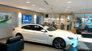 bmw m showroom featuring digital dealership system for auto