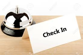 check in desk sign service bell with check in sign at hotel desk stock photo picture