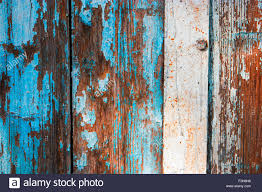 weathered wood planks half painted in blue stock photo royalty