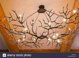 looking up illuminated antlers chandelier above dining room table