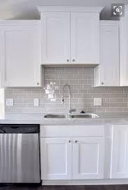 white shaker kitchen cabinets with white subway tile backsplash the white shaker cabinet gray subway tile kitchen