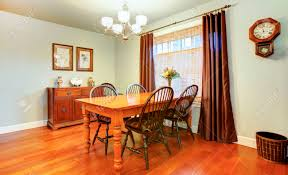 light tones dining room with wood dining table set rustic wall