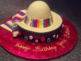 sombrero cake with fondant buttons hanging for the birthday girls