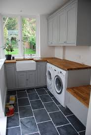 slate floor apron front sink and lots of light laundry room