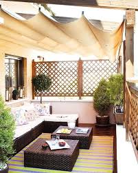 exterior covered outdoor balcony design using wicker furniture