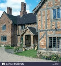 large build tudor style country house with brick timber