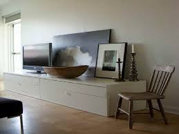 revamp your shabby interior with several chic long media cabinet