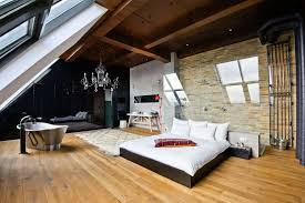 bedroom glamorous loft bedroom with large chandelier plus brick