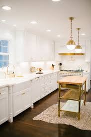 283 best images about kitchens on pinterest transitional kitchen white kitchen hicks pendant brass butcher block island