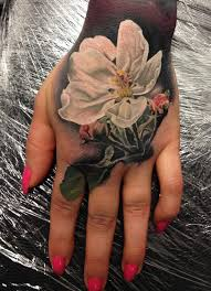white flower hand tattoo best tattoo design ideas