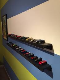 ribba shelf from ikea used to display wheels cars we hung the