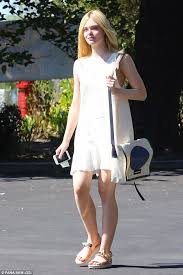 elle fanning wears sundress with bag made from recycled materials