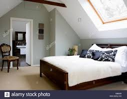 Attic Bedroom by Cream Carpet And Bed Cover In Modern Attic Bedroom With Antique