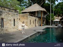 hotel pool area of a classy lodge como shambhala resort in ubud