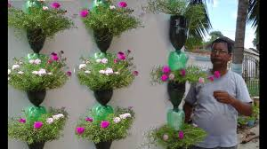 Planters That Hang On The Wall Tree Planting In Hanging Bottles On Wall Youtube
