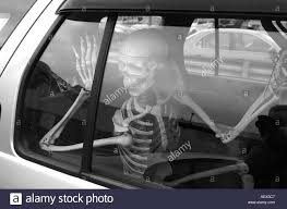 scary halloween photos free scary halloween display skeleton in the rear seat of a car stock