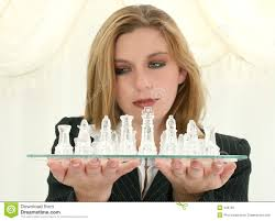 beautiful twenty five year old business woman with chess set stock