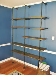 Steel Pipe Shelving by Diy Industrial Pipe Bookshelf Brass Peacock