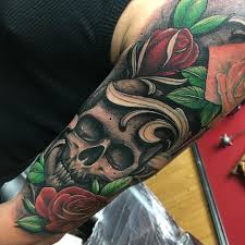 skin deep tales craigholmestattoo skull and roses sleeve