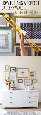 how to hang photo frames on wall without nails how to hang a perfect gallery wall without nails gallery wall