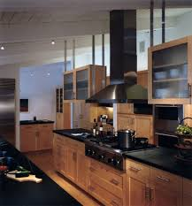 dark maple cabinets kitchen traditional with artificial plants and