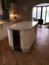 kitchen island worktops howdens burford kitchen units installed with quartz biscuit