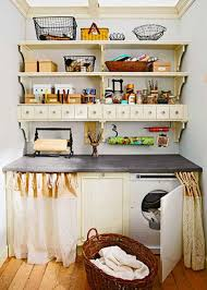 narrow small apartment kitchen storage over laundry room cabinet