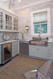 white quartz countertops and the backsplash is carrera marble