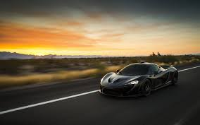 mclaren supercar p1 mclaren p1 black mclaren supercar car car in motion hd wallpaper