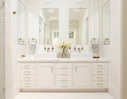 master bathroom white vanity with two sinks and large mirrors 5