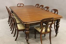 victorian dining table with matching chairs in mahogany