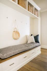 long wood top mudroom bench with shiplap walls transitional