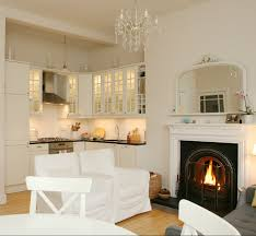 a new england style white kitchen part of a living space
