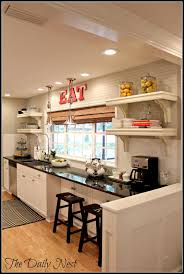 awesome galley kitchen i adore the use of 12 inch cabinets there awesome galley kitchen i adore the use of 12 inch cabinets there next to the
