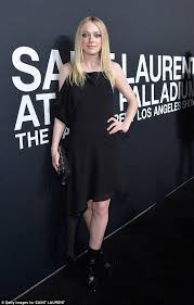 dakota and elle fanning dare to be different at saint laurent show