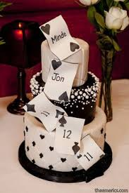 las vegas inspired wedding cake with hearts spades diamonds and