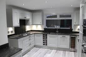 grey kitchen cupboards with black worktop worktop envy kevin richardson installations ltd