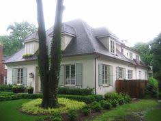 french home with gray shutters transitional home exterior home