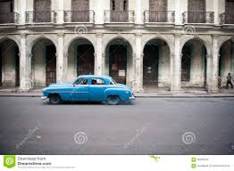 old blue car colonial architecture havana editorial photography