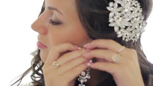 earrings girl beautiful girl wears earrings on wedding day stock footage