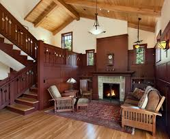 living room with vaulted ceiling fireplace with tile surround living room craftsman with high beam