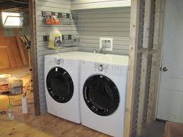 Storage Ideas For Small Laundry Rooms by Using Slatwall For Laundry Room Organization To Finish Wall