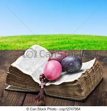 decorative eggs that open decorated with painted easter eggs and an open bible wooden