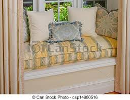 Bay Window Cushion Seat - stock photography of a seating area in a bay window with