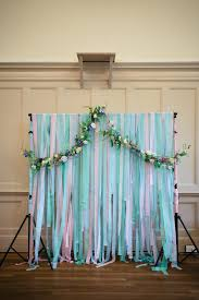 wedding backdrop garland a pale green 40 s inspired dress and floral crown for an eclectic