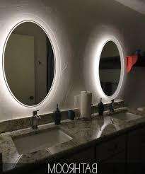 adorable bathroom lights decors set on surrounding oval mirror