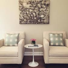 ivory accent table and green living room with marble saarinen side table