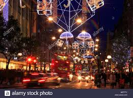 Christmas Decorations Street Lights by Colourful Christmas Decorations In Oxford Street London Uk Stock