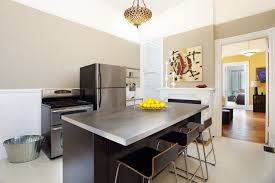modern kitchen with kitchen island by jesse fowler zillow digs