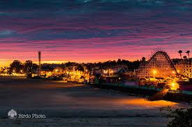 the santa cruz beach boardwalk at sunset birdo photo santa